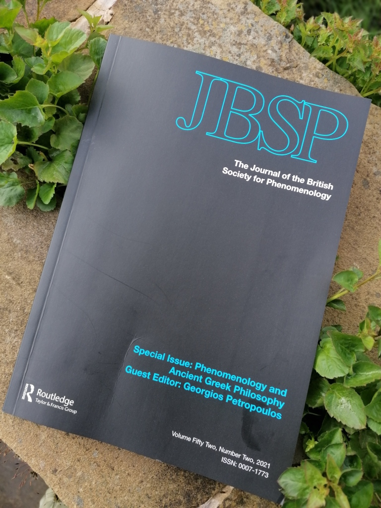 A copy of the Journal of the British Society for Phenomenology, special issue Phenomenology and Ancient Greek Philosophy, Guest editor Georgios Petropoulos. A matte black cover with turquoise letters JBSP.